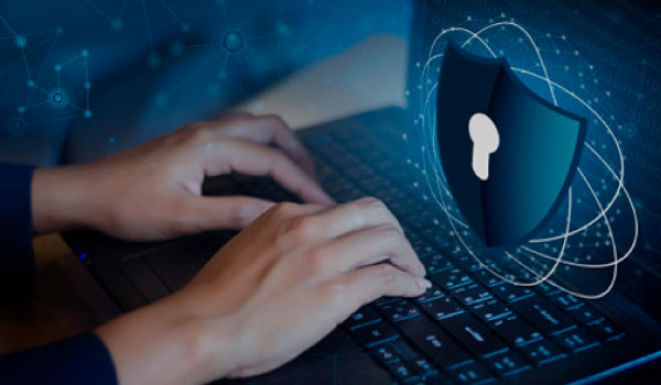 cybersecurity worker typing on keyboard